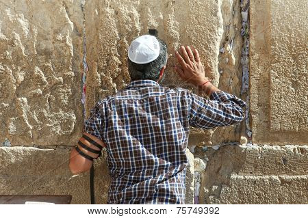 People pray at the wailing wall