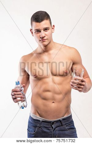 Muscular Fitness Man Holding Bottle And Wather
