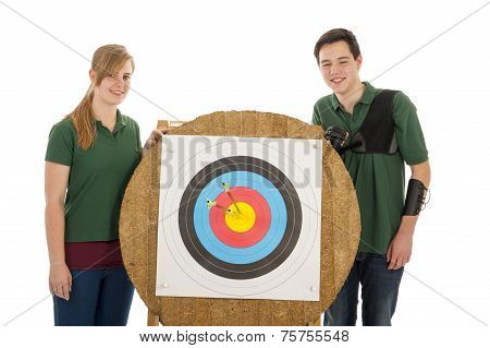Girl And Boy Standing Besides Archery Target