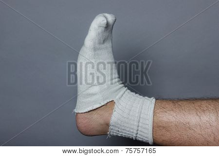 straight leg with a big hole in the sock
