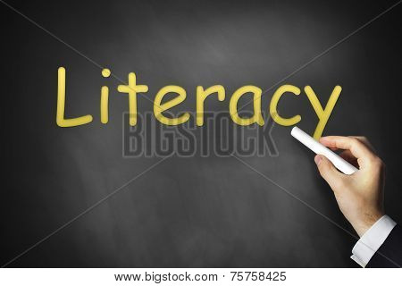 Hand Writing Literacy On Black Chalkboard