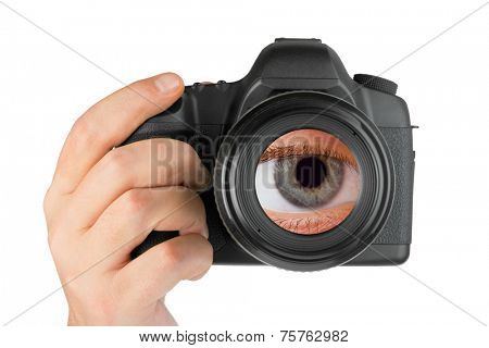Photo camera in hand and eye in lens isolated on white background