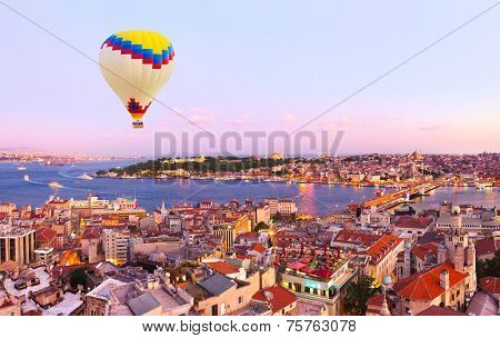 Hot air balloon over Istanbul sunset - Turkey travel background