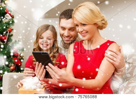 christmas, holidays, technology and people concept - smiling family with tablet pc taking selfie at home