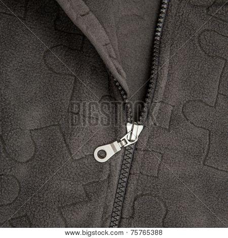 Close up zipper on a black background