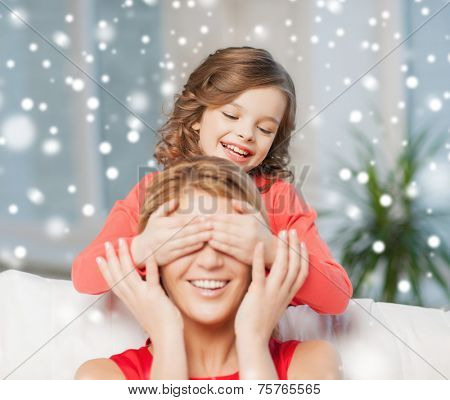 people, motherhood, family, winter and adoption concept - happy mother and daughter playing and having fun at home