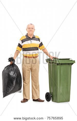 Full length portrait of a senior man holding a bag of trash isolated on white background