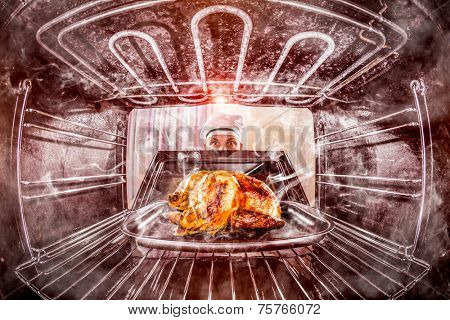 Funny chef overlooked roast chicken in the oven, so she had scorched, view from the inside of the oven. Cook perplexed and angry. Loser is destiny!