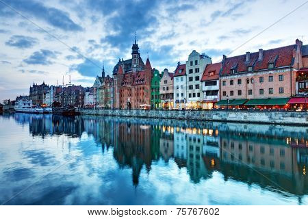 View of Gdansk old town and Motlawa river, Poland at romantic sunset. The city also known as Danzig and the city of amber.