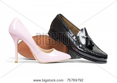 Luxury man's shoes and pink women's heel shoe isolated over white with clipping path.