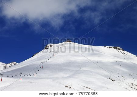 Ropeway And Ski Slope In Sun Day