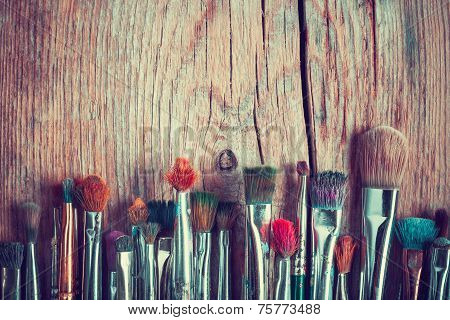 Row Of Artist Paintbrushes Closeup On Old Wooden Table, Retro Stylized