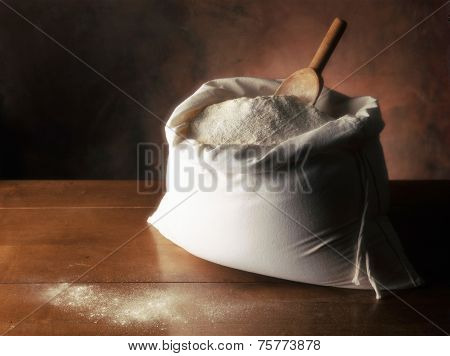 Flour In Canvas Bag On Wooden Table