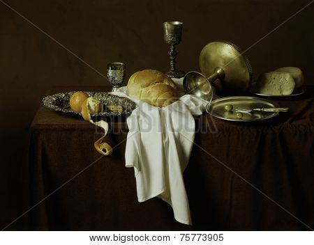 Still Life, Old Style Image Of Bread, Cheese, Olives, Oranges On A Brown Table