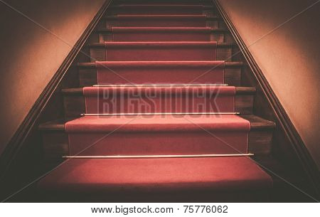 Red carpet on wooden steps