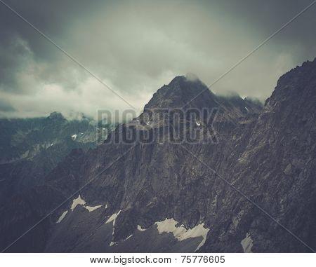 Fog over high mountain peak