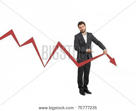 sad broker pointing at falling down graph. isolated on white background