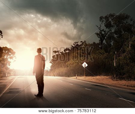 Rear view of businessman standing on road