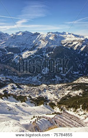 View To The Town In The Swiss Alps From High Mountain