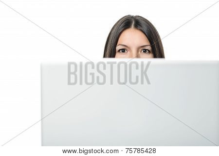 Young Woman Behind The Monitor Of A Desk Computer