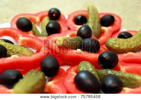 Black Olives, Marinaded Cucumbers And Paprika