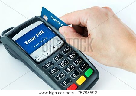 Hand With Credit Card Swipe Through Terminal For Sale. Enter Pin On Display