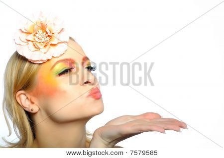 Concept Of Summer Fashion Woman With Creative Eye Make-up In Yellow And Green Tones Sending Kisses.