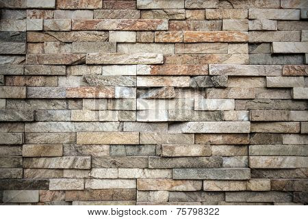 Abstract weathered texture of stained old dark stucco brown and painted red, yellow brick wall background in rural room Grungy rusty blocks of stonework tech darken retro color architecture wallpaper