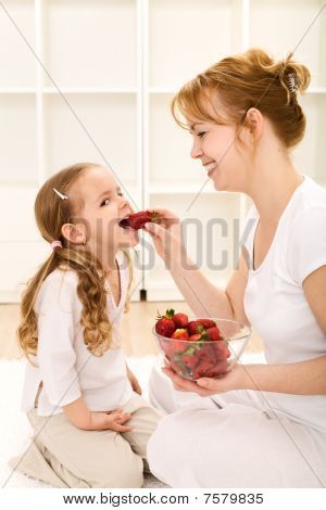 Happy Healthy People Eating Fresh Strawberries