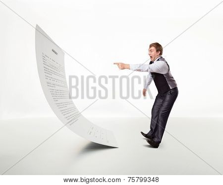 Afraid man points to the document