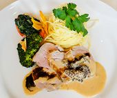 image of morels  - pork fillet with morel sauce noodles broccoli and spinach served in a white plate - JPG