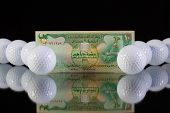 stock photo of dirhams  - Money from Emirates on the black glass desk - JPG