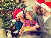 picture of father child  - Christmas Family with Kids opening Christmas gifts - JPG