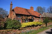Medieval brick and timber cottage poster
