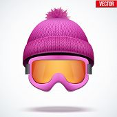 stock photo of knitted cap  - Knitted woolen pink cap with snow goggles - JPG