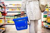 foto of grocery store  - Pretty young woman buying groceries in a supermarket - JPG