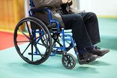 image of ward  - Disabled senior man using a wheelchair in a hospital ward - JPG