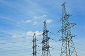 pic of transmission lines  - Transmission lines on the background against the blue sky - JPG
