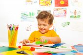 pic of paper craft  - Happy small boy crafting with scissors - JPG