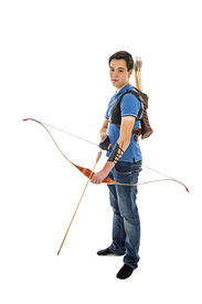 stock photo of longbow  - Boy with blue shirt and jeans standing with a longbow - JPG