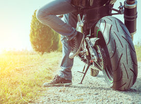 picture of biker  - biker taking a break after long ride - JPG