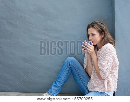 Attractive Mid Adult Woman Enjoying A Cup Of Tea