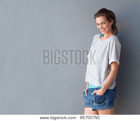Happy Beautiful Mid Adult Woman Smiling Against Gray Background