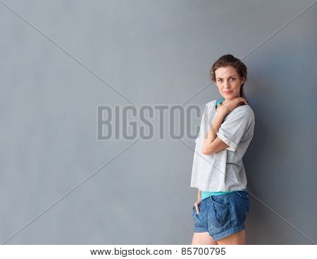 Modern Mid Adult Woman Posing Against Gray Background