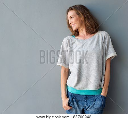 Cheerful Mid Adult Woman Smiling And Looking To The Side
