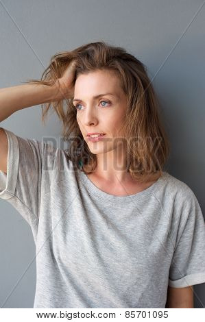 Charming Mid Adult Woman Posing With Hand In Hair