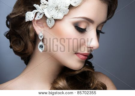 Portrait of a beautiful woman in a wedding dress in the image of the bride. Beauty face