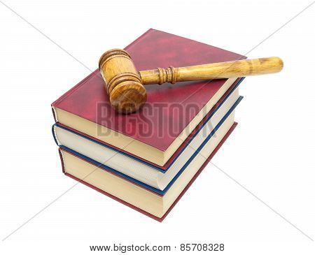 Gavel Lying On A Pile Of Books Isolated On White Background