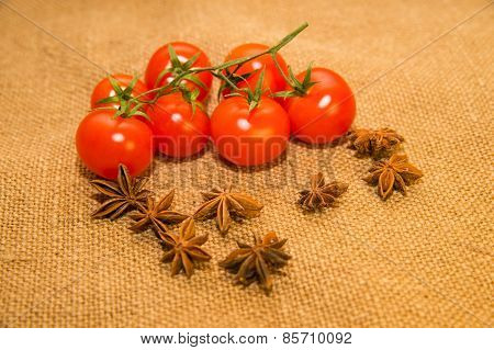 Red Tomats And Star Anise Fruits On Old Cloth