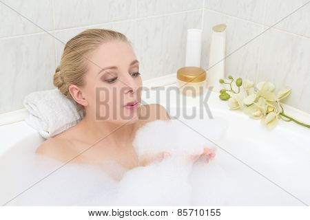 Young Woman Playing With Foam In Bath